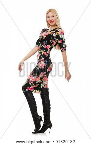 Cute blonde girl in floral dress isolated on white