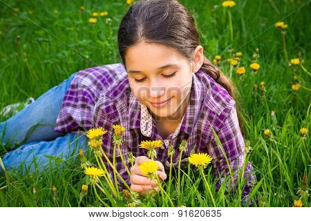 Cute girl on field with dandelions