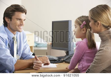 Doctor talking to mother and child