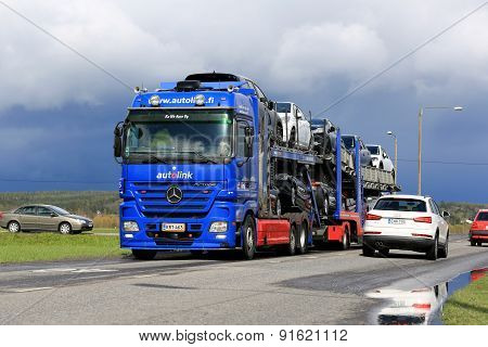 Mercedes-benz Actros Car Carrier Hauls New Cars In Traffic