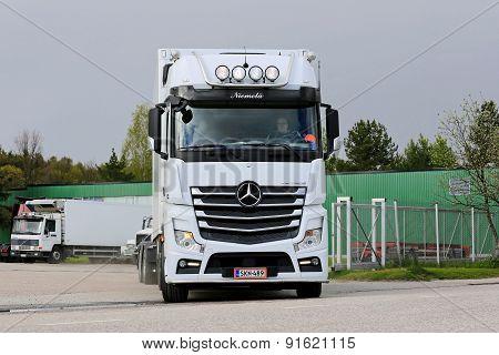 Mercedes-Benz Actros Exits Truck Depot