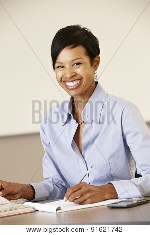 African American teacher working at desk