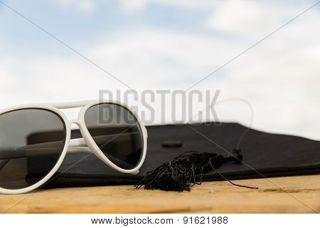 Sunny Background With Mortarboard