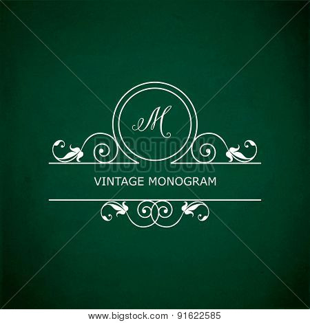 Monogram of the letter M, in retro floral style on green chalkboard background.