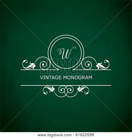 Monogram of the letter W, in retro floral style on green chalkboard background.