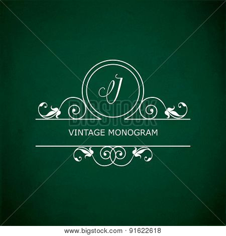 Monogram of the letter J, in retro floral style on green chalkboard background.