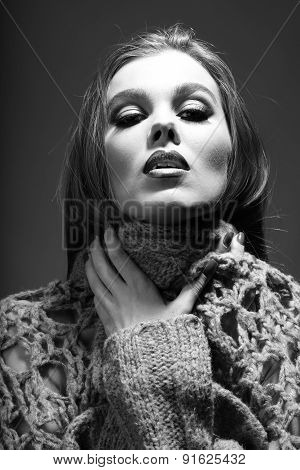 Portrait Of Tender Passionate Woman In Knitted Jacket