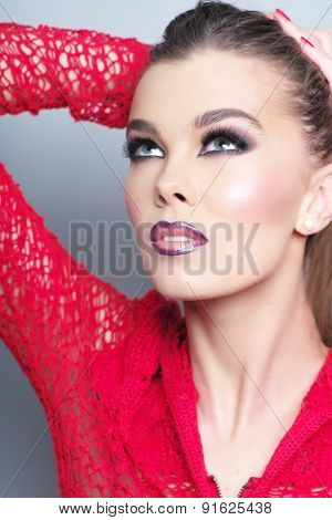 Portrait Of Pretty Girl In Red Knitted Jacket