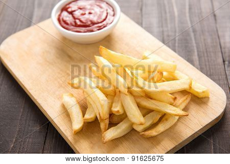 French Fries With Ketchup On Wooden Background