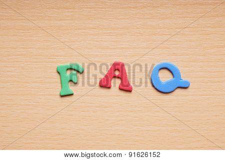 FAQ in foam rubber letters