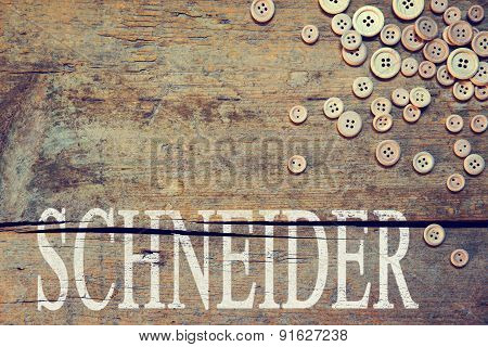 Wooden Background With The German Word For Tailor