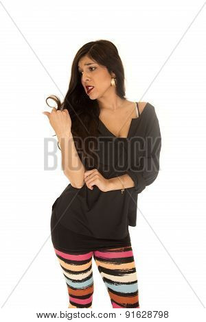 Cute Woman Looking At Her Hair Split Ends Frustrated