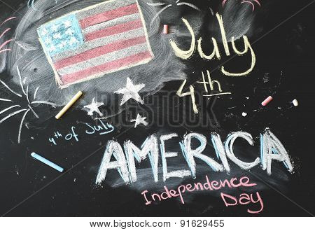 black chalkboard in classroom with American flag...4 th of July
