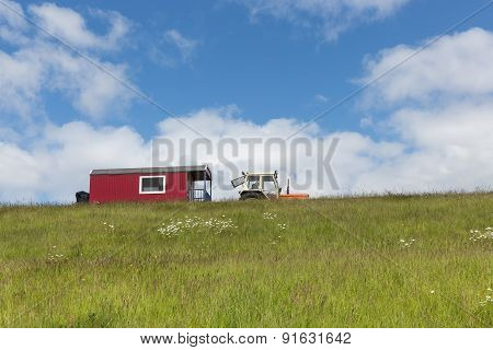 Silhouette Of Tractor With House Trailer Against A Blue Sky