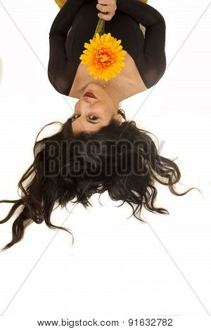 Beautiful Woman Laying Down Holding A Big Yellow Flower