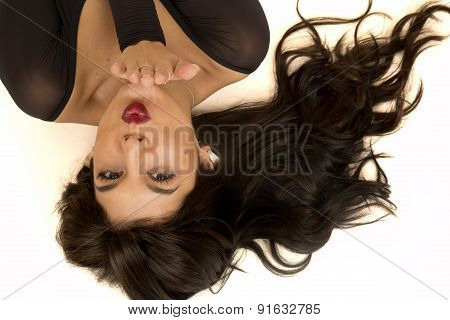 Portrait Of A Beautiful Woman Laying Down Blowing A Kiss