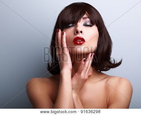 Beautiful Makeup Woman Touching Face. Red Lipstick And Manicured Hands