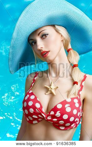 Portrait of sensual girl in red dots swimsuit on vacation