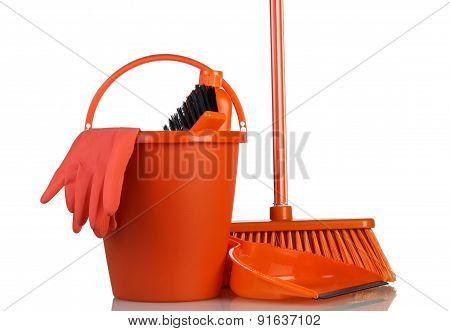 Cleaning tools in orange bucket