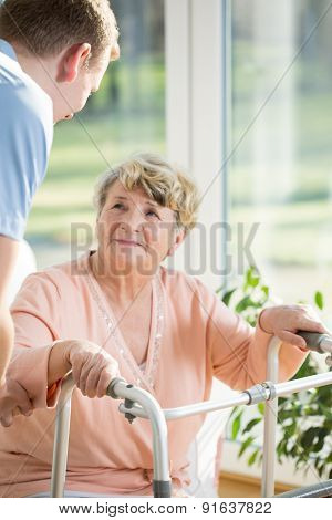 Elderly Woman With A Walker