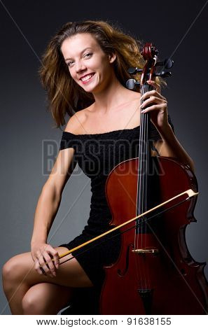 Female musical player against dark background