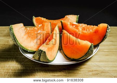 Slices Of Orange Melon On The Plate