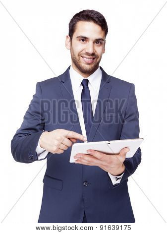 Smiling business man standing with tablet computer, isolated on white background