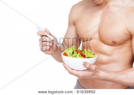 Image of a fitness man holding a bowl of salad, isolated on white background