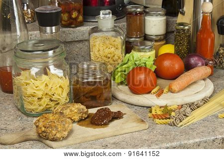 Homework pasta dishes. Pasta, spices and vegetables on the kitchen table