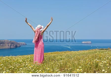 Woman In A Long Summer Dress Standing In A Field Of Daisies