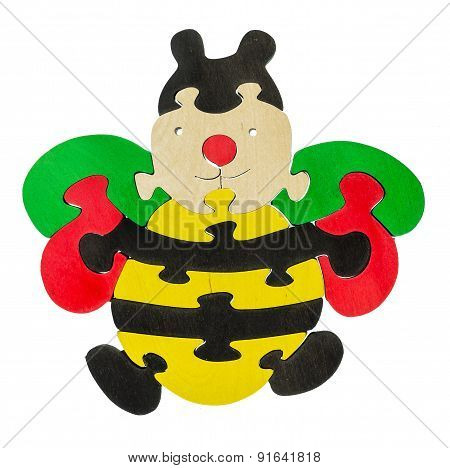 Colorful wooden puzzle in bee shape on isolated background