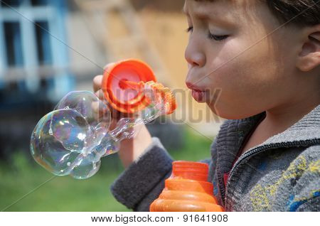 Boy Inflating The Bubble