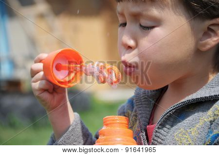 Kid Blowing The Bubbles