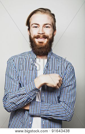 Stylish bearded man in  shirt. Close up portrait over grey background.
