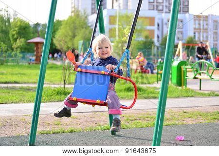 Little Girl Having Fun On A Swing Outdoor