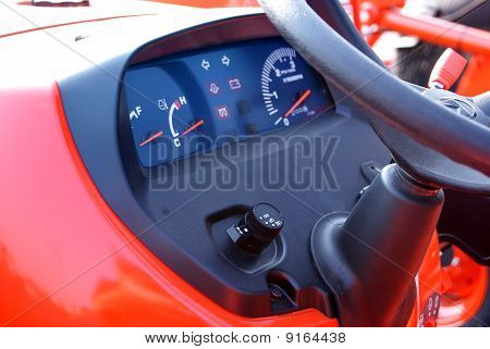 Close up of a new red tractor dashboard