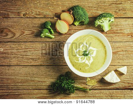 Fresh broccoli soup in a bowl with ingredients