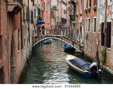 Venice, Italy - 22 May 2105: View Of A Side Canal And Old Buildings In The Centre Of Venice.
