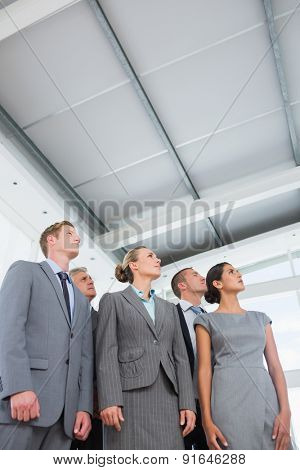 Business team looking up in the office