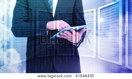 Businessman touching his tablet pc against server room