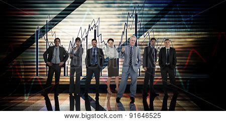 Business people against stocks and shares on black background