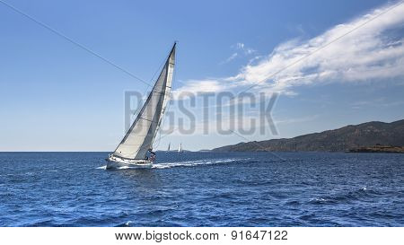 Sailing. Yacht sails with beautiful cloudless sky.