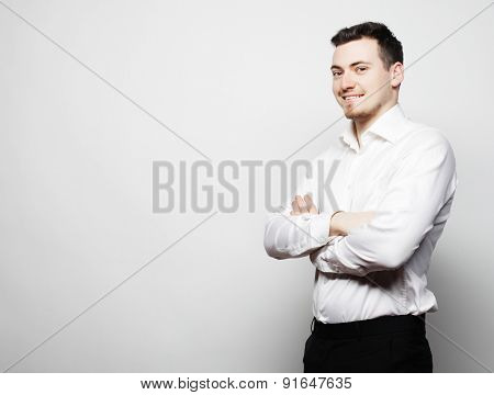 business, success and people concept - young business man wearing white shirt, isolated on white.