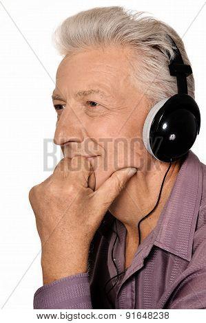 Elderly man listen to music in headphones