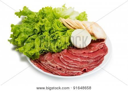 Raw fresh thinly sliced meat with lettuce, mushrooms and onions for grilling. From a series of Food Korean cuisine.