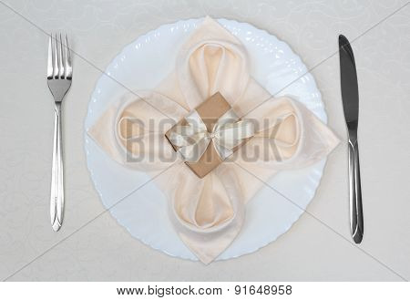 Gift box on plate