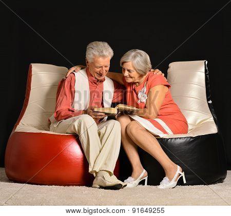 Fashionable elderly couple in studio