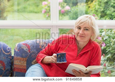 Blonde Middle-aged Woman Is Relaxing