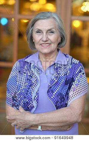Senior woman near window