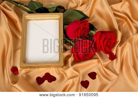 Roses and frame on golden cloth